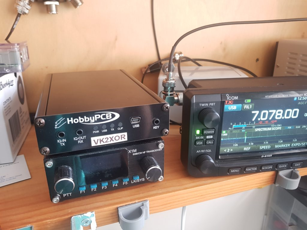 Photo showing RS-HFIQ and X1M Pro next to IC-705